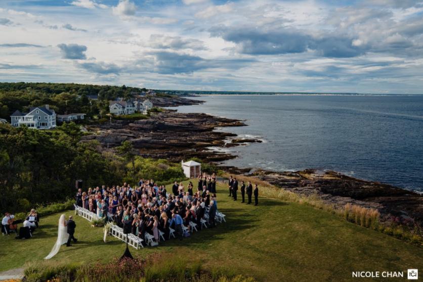 An aerial view of a wedding ceremony with a string quartet providing the wedding ceremony music.