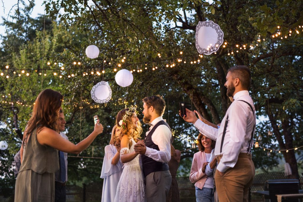 planning a backyard wedding with stringed lights and a few guests