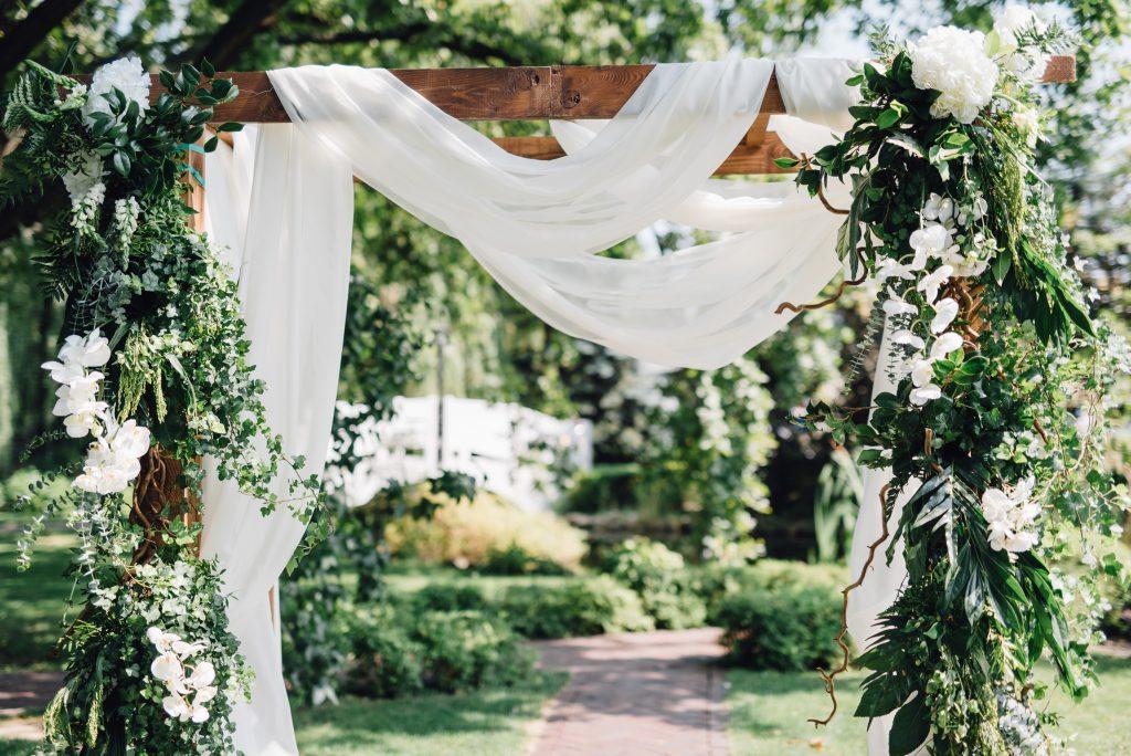 backyard wedding planning ceremony archway idea