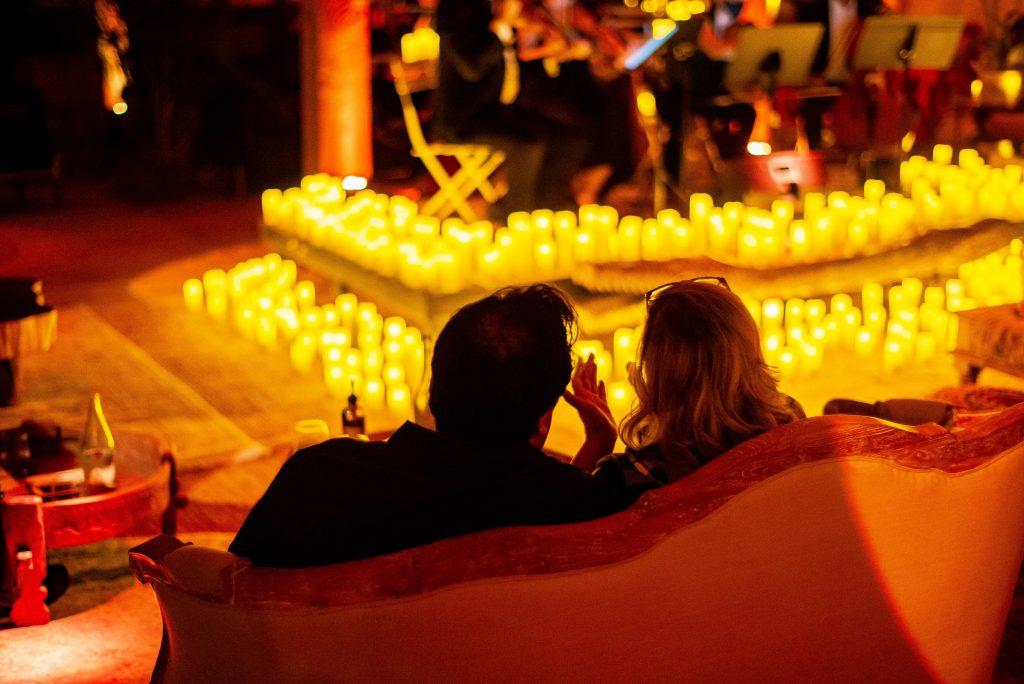 wedding anniversary idea candlelit concert couple